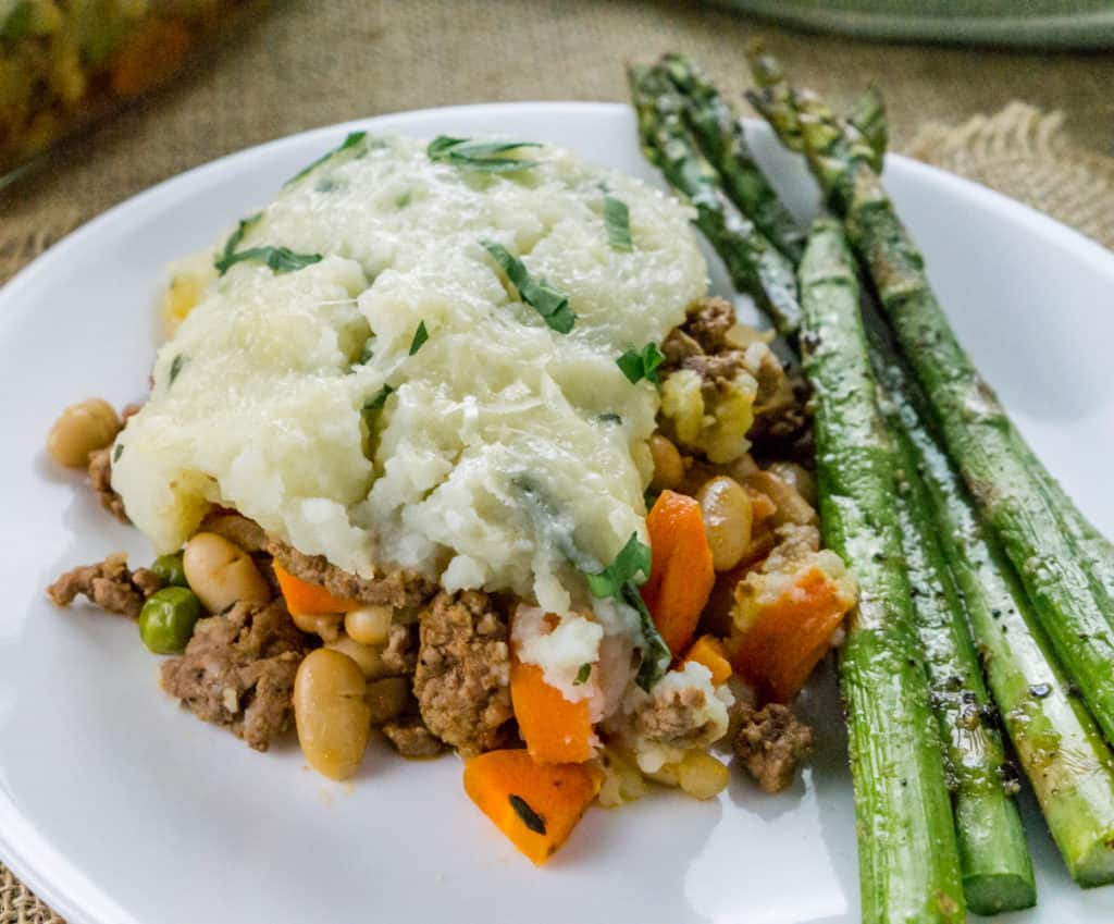 This Shepherd's Pie with White Beans is the ultimate comfort food casserole using leftover mashed potatoes and other hearty ingredients.