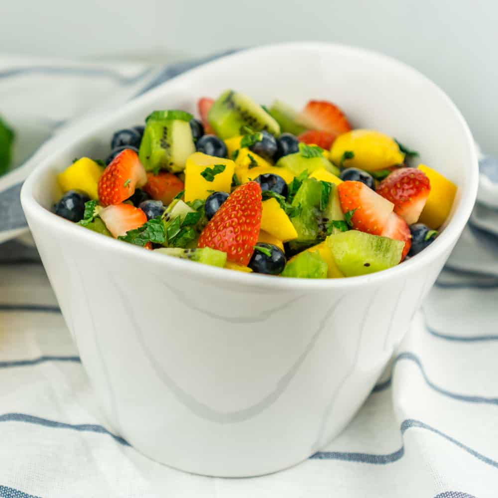 Enjoy this gorgeous Fruit Salad with Honey Lime Dressing as a healthy snack or as dessert for your next cookout!