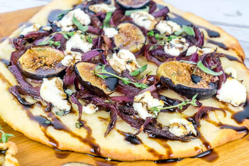 Caramelized Onion, Fit, and Goat Cheese on top of a flatbread - from Babaganosh.org