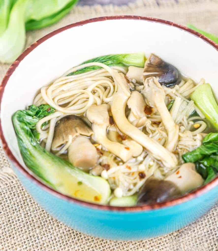 Close up shot of bowl of Three Mushroom Soup with Soba Noodles, Lemongrass, and Ginger | Babaganosh.org