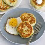 bubble and squeak cakes on a plate with a fried egg
