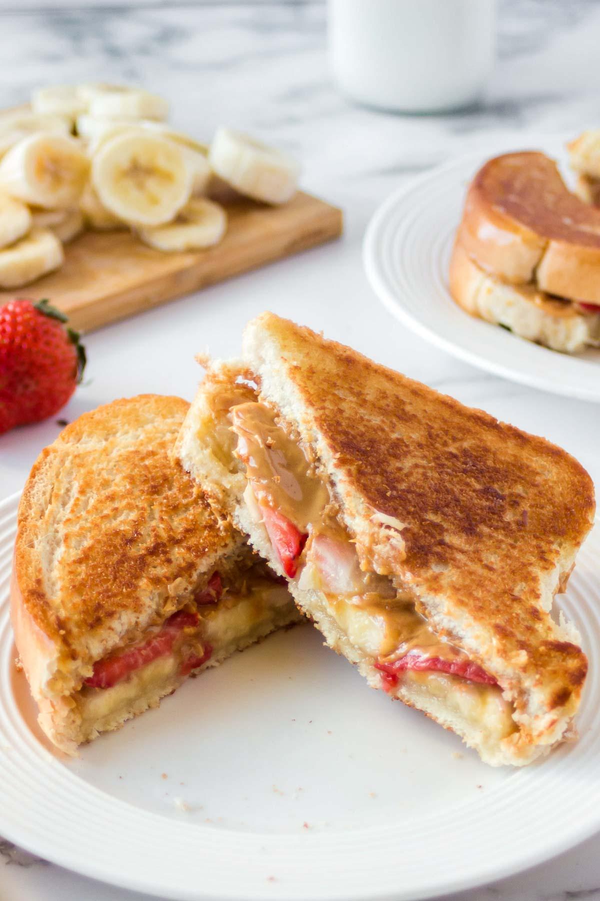Grilled peanut butter honey sandwich on a plate.