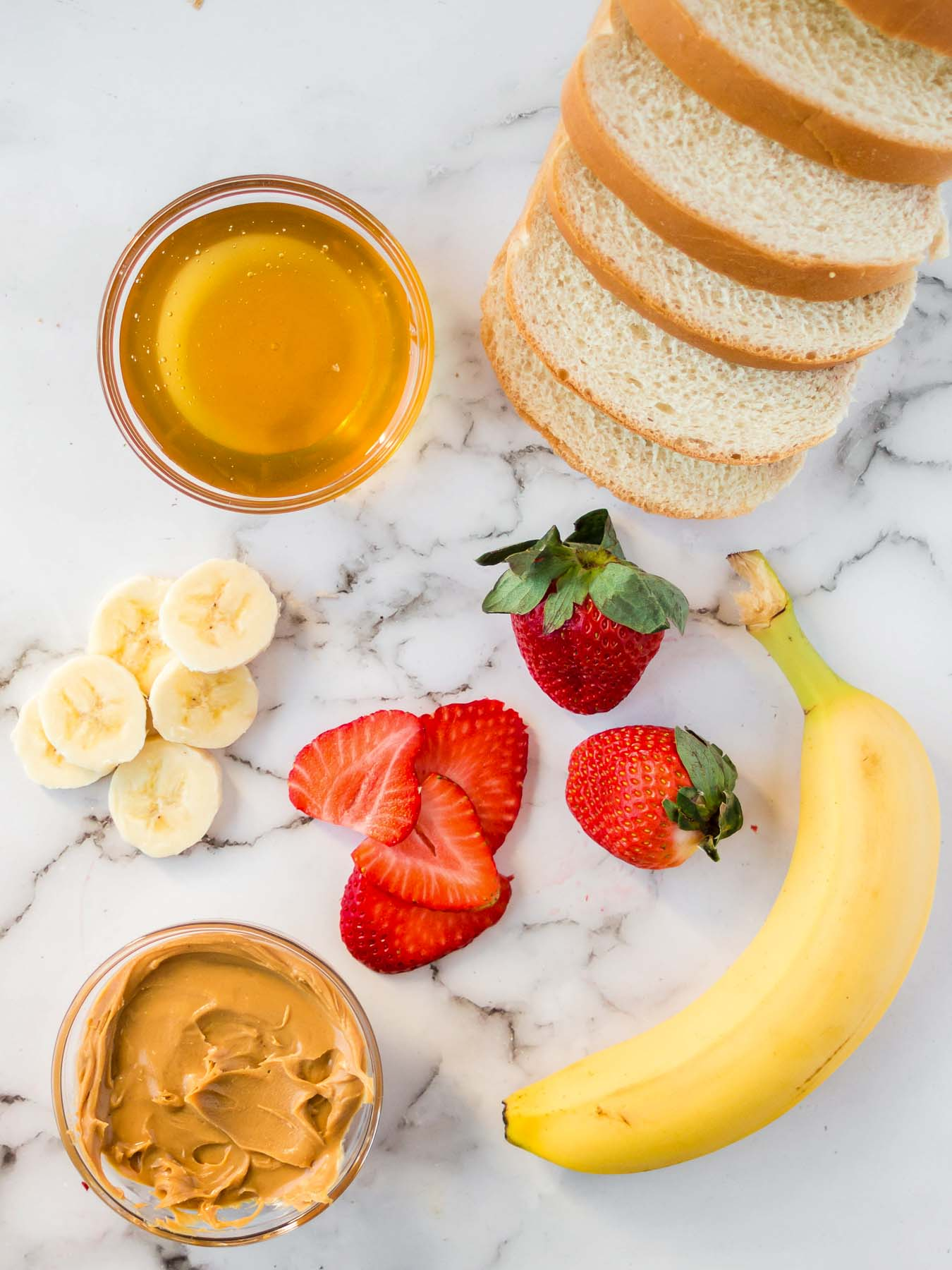 Ingredients to make grilled peanut butter honey banana sandwiches.