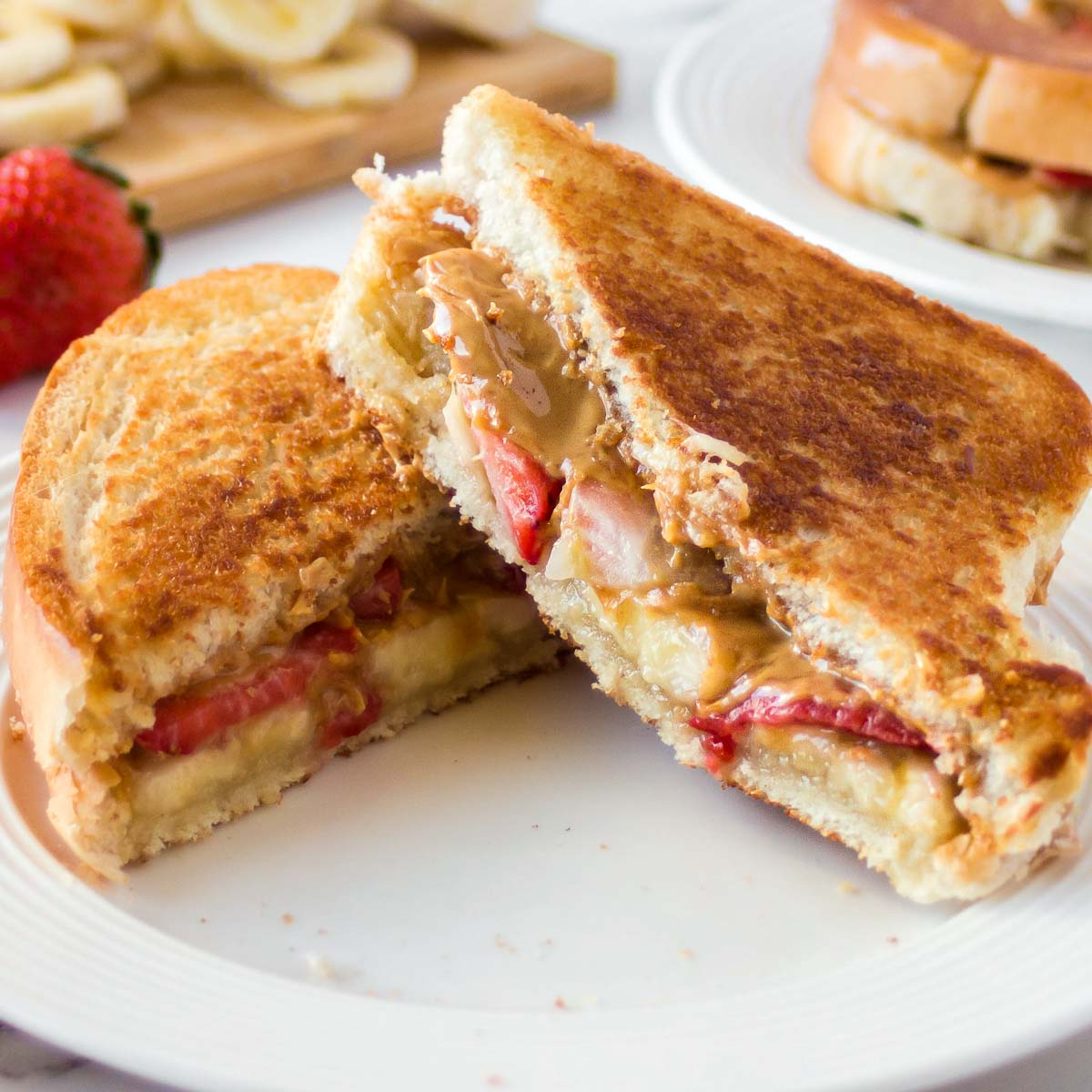 Grilled peanut butter sandwich on a plate.