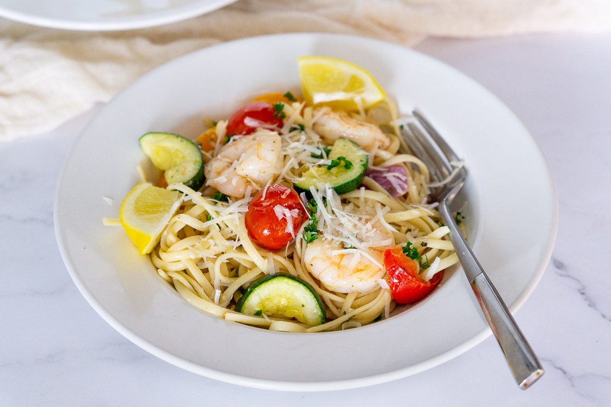 shrimp and vegetable linguine on a plate