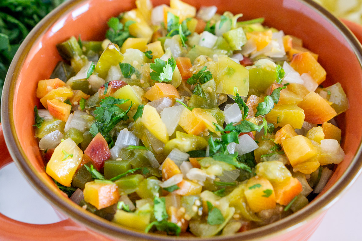 close up of roasted peach tomatillo salsa in a bowl