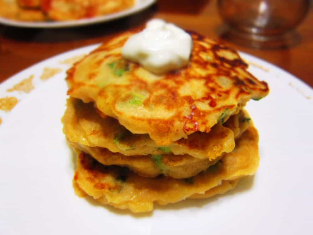 Cheesy Savory Pancakes with Scallions, served with Lime Crema