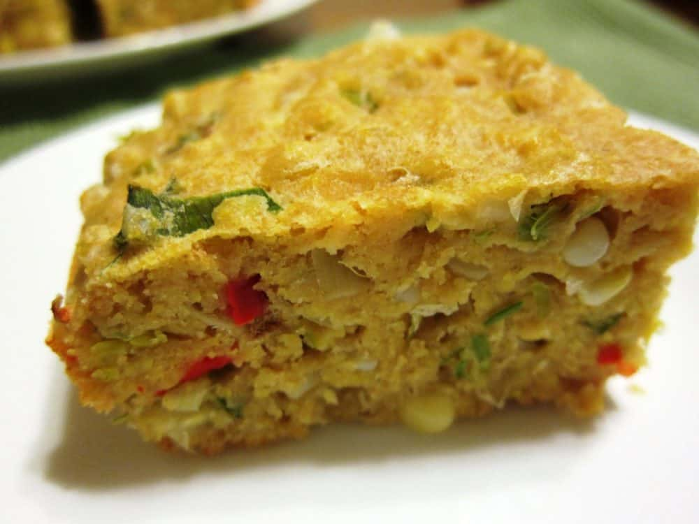 savory cornbread with leeks and cherry peppers on a plate