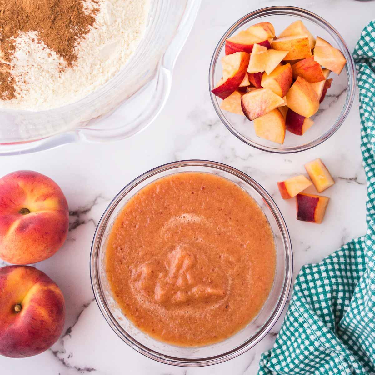 Peach puree and chopped peaches for making peach bread.