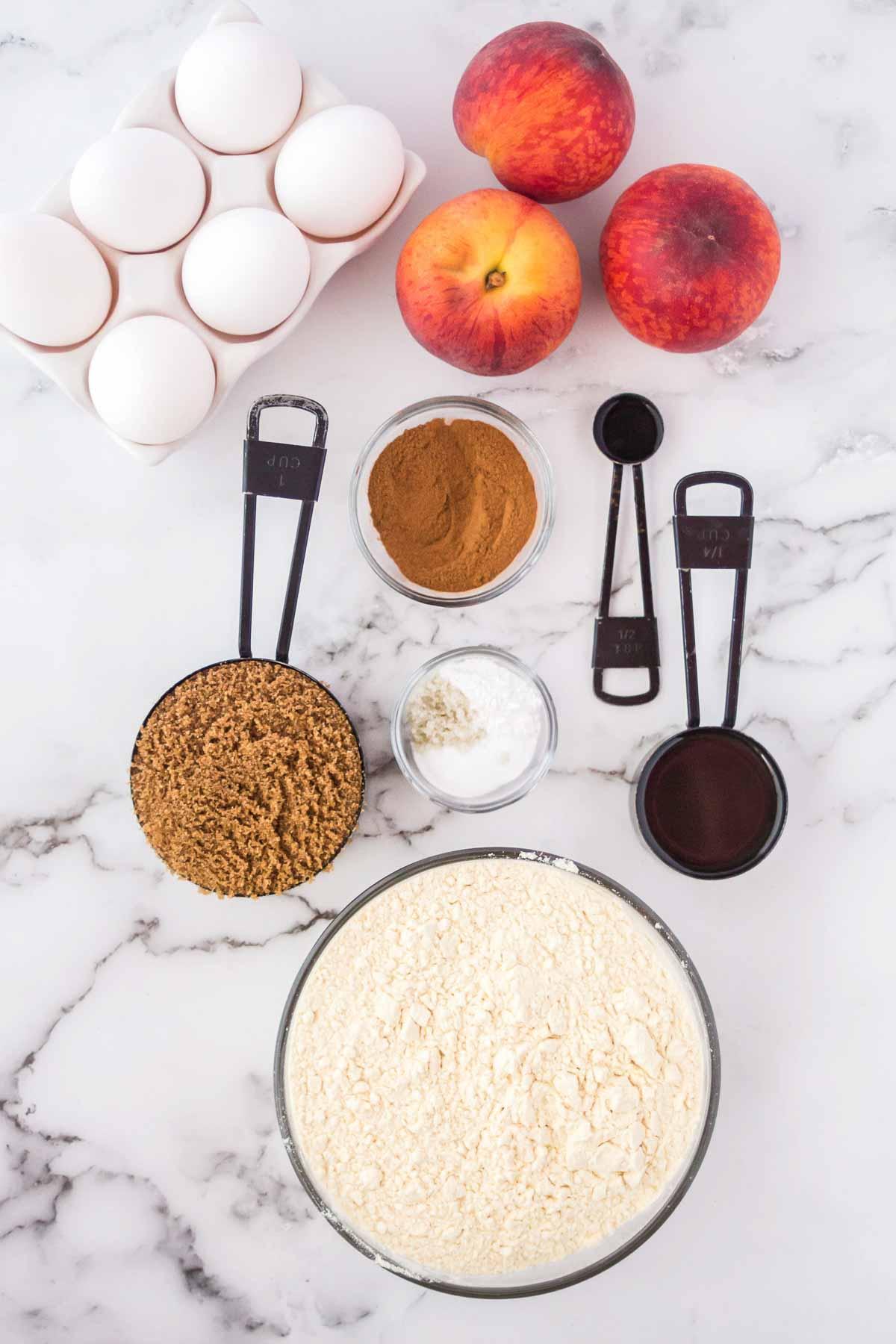 Ingredients to bake peach bread.