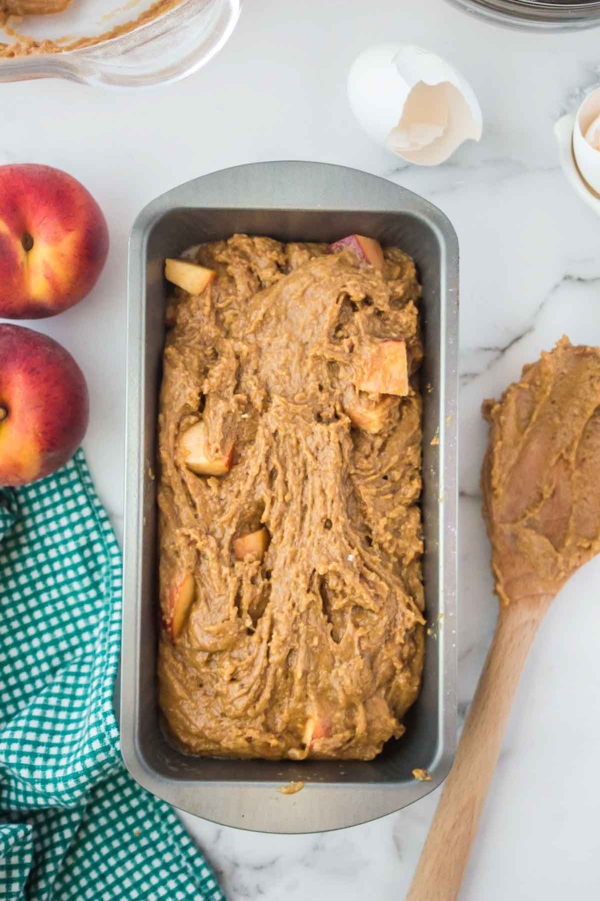 Peach bread batter in a pan.