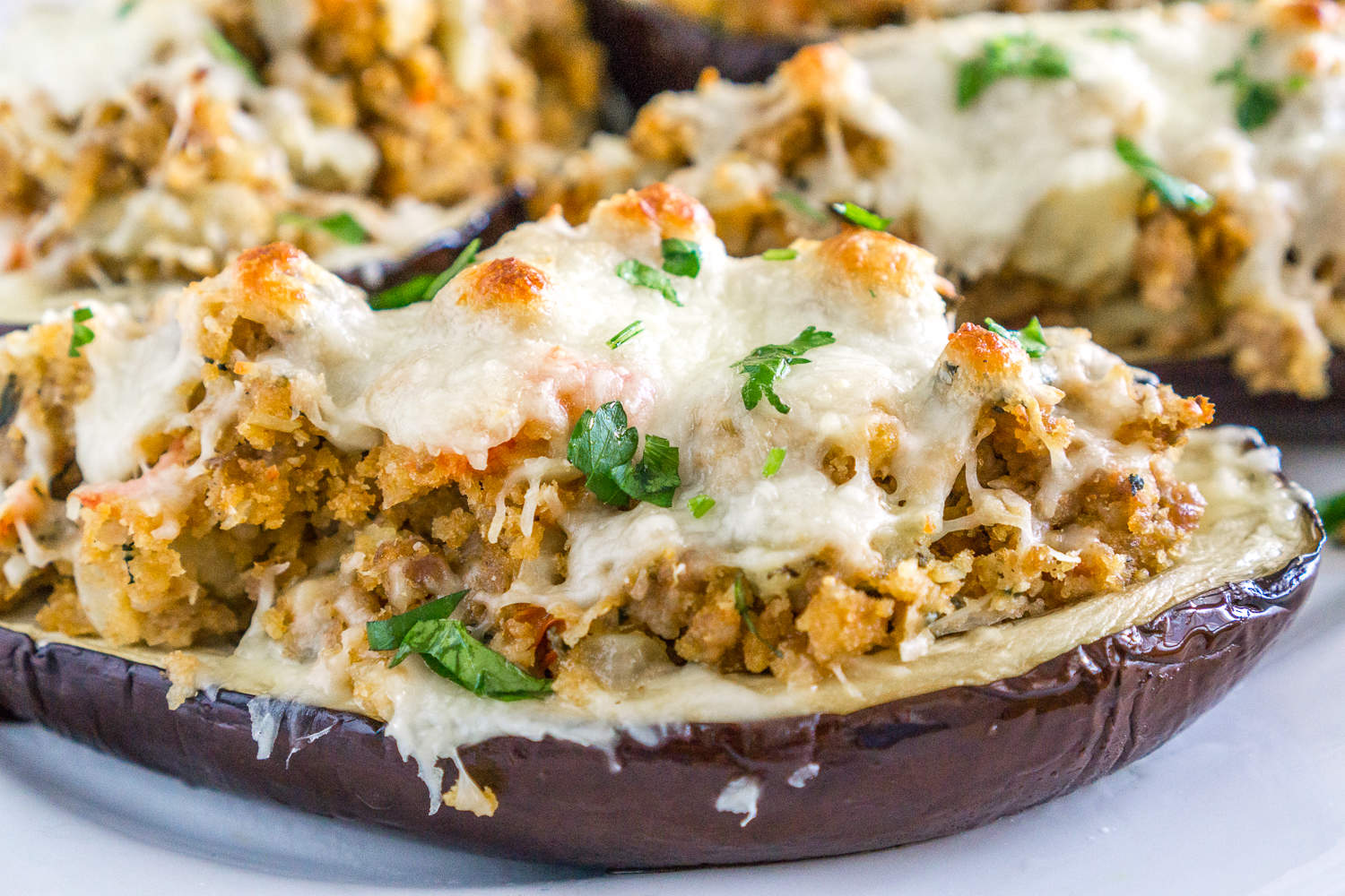 eggplant stuffed with sausage topped with cheese