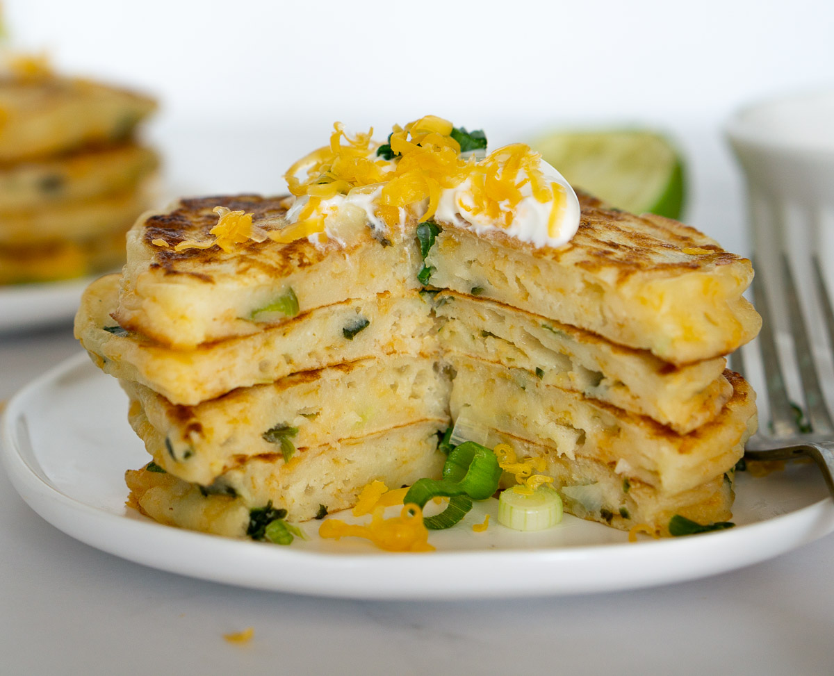 stack of savory pancakes cut open