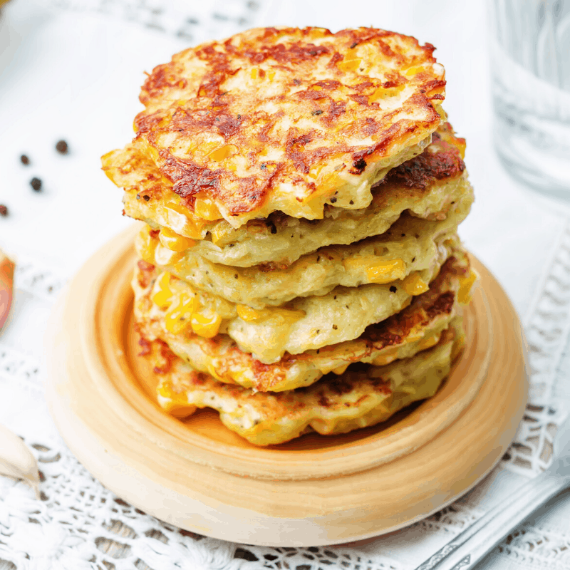 stack of corn fritters on a plate