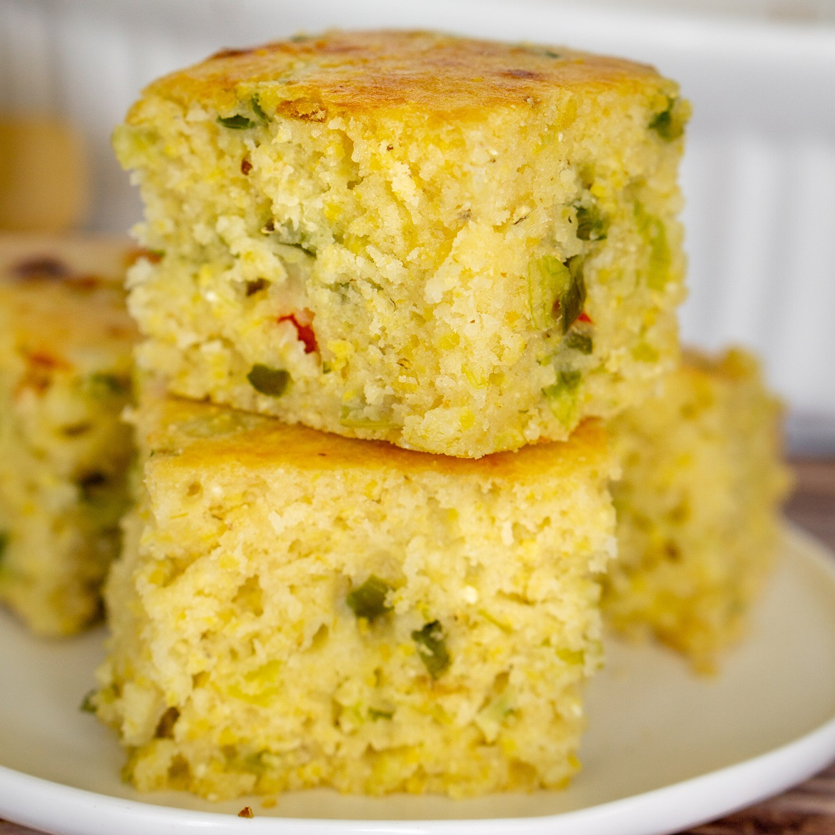 stack of savory cornbread pieces on a plate