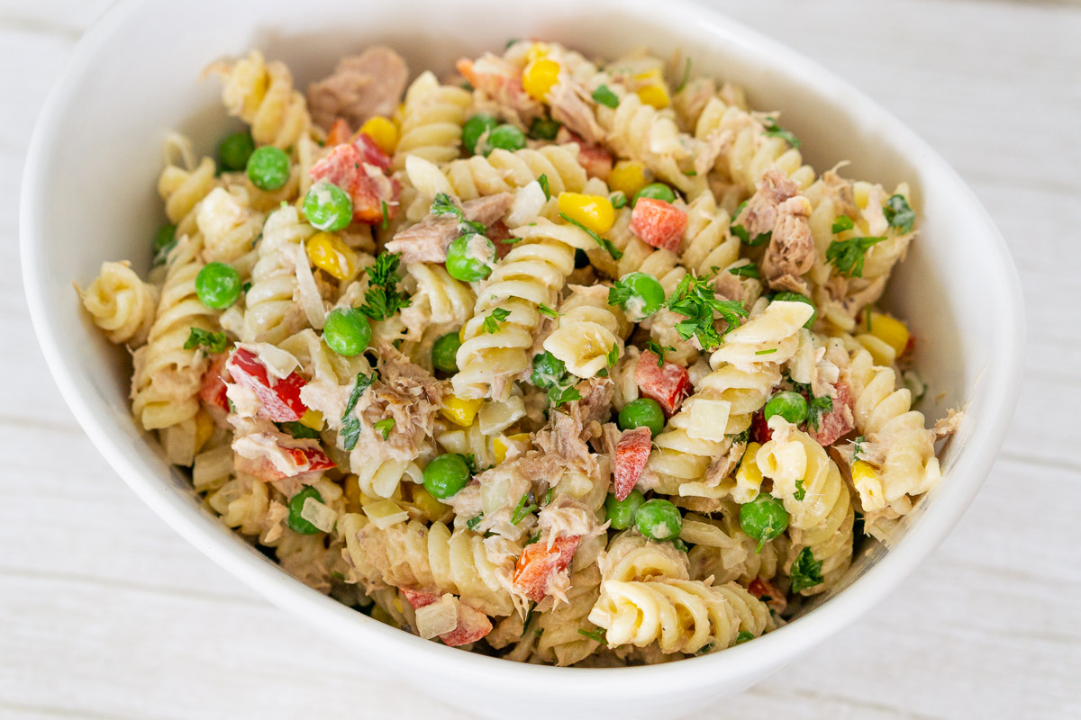 tuna pasta salad with vegetables in a bowl