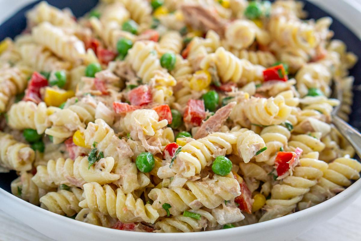 close up of tuna pasta salad with peas