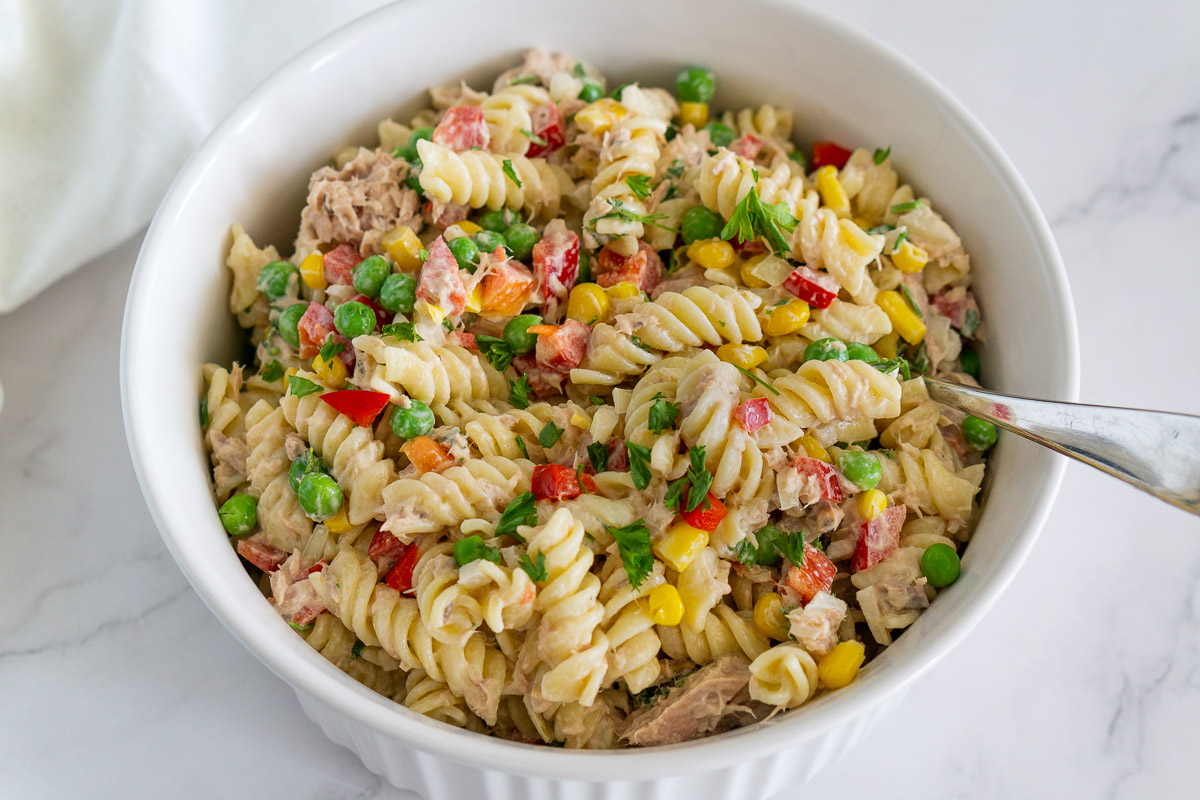 tuna pasta salad with peas in a bowl