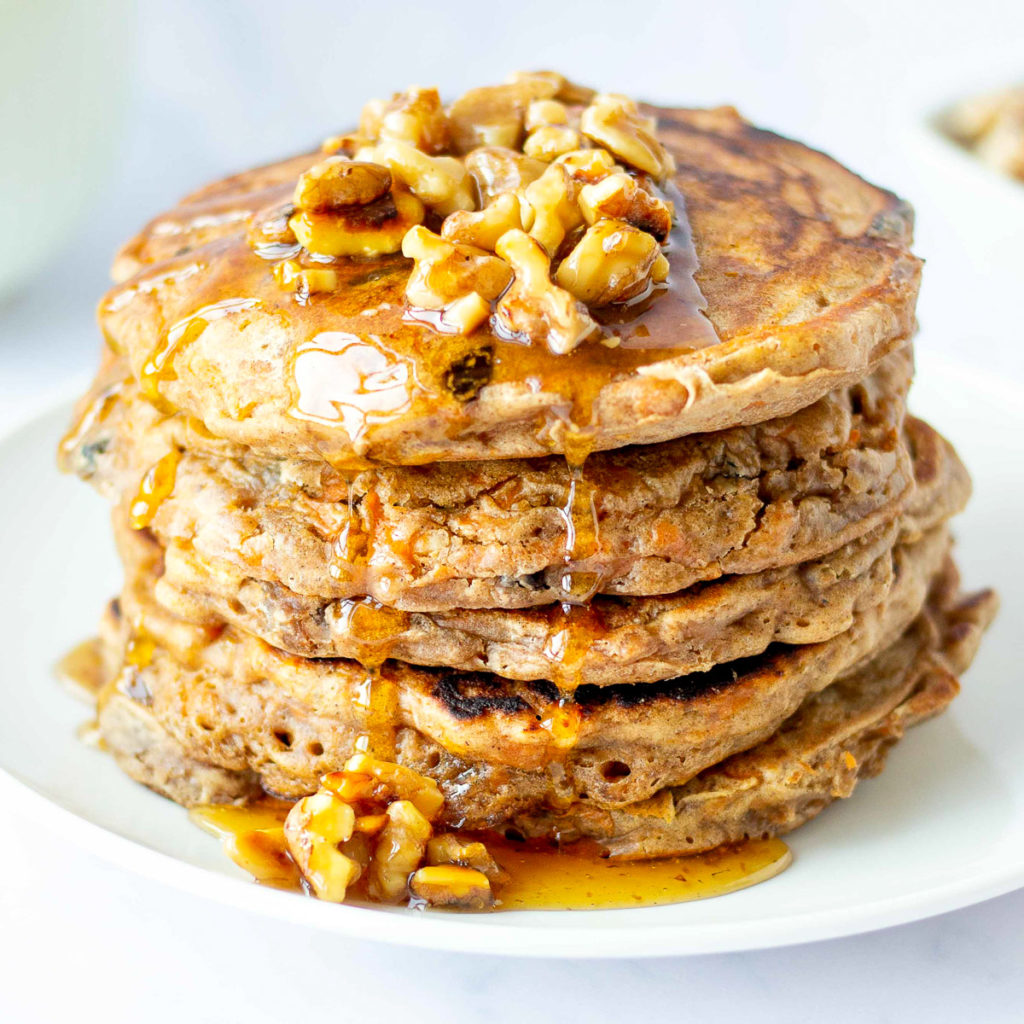 stack of healthy carrot cake pancakes with walnut syrup