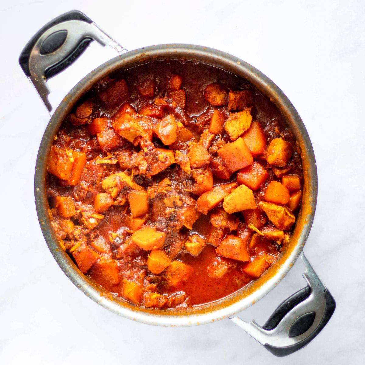 overhead view of Moroccan chicken pumpkins stew in a pot