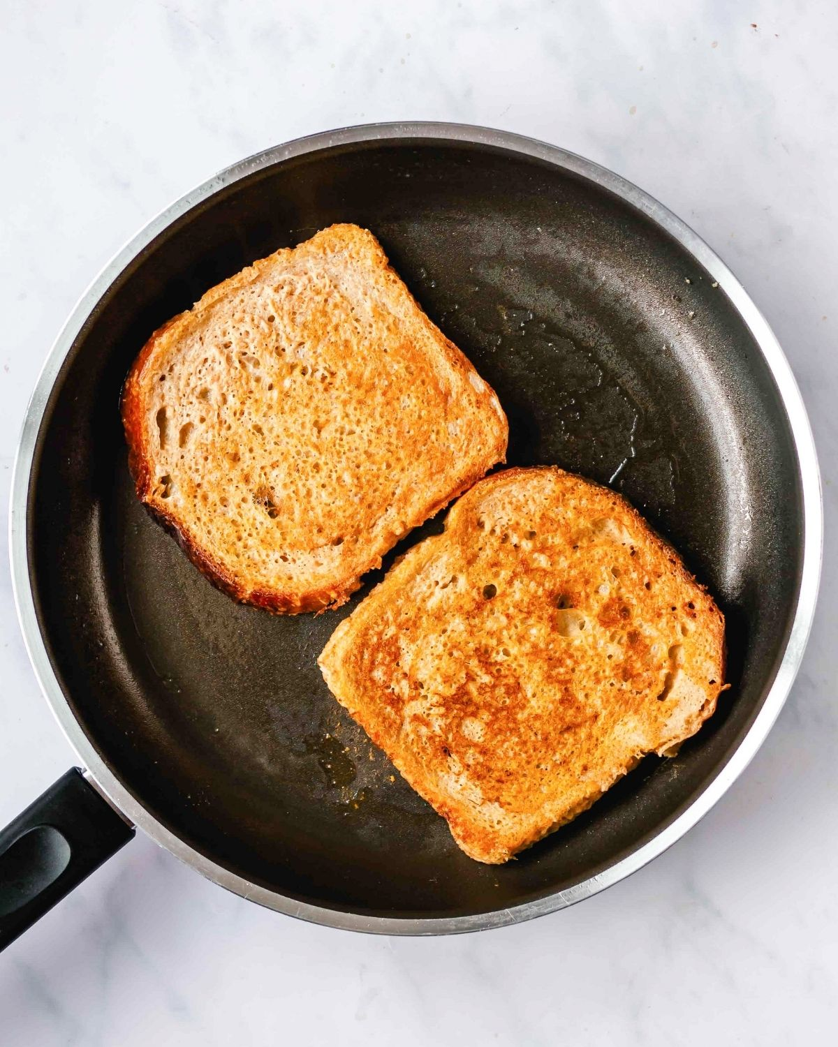 cooking pumpkin french toast in a skillet