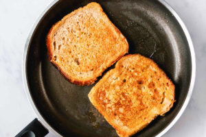 pumpkin french toast frying in a skillet