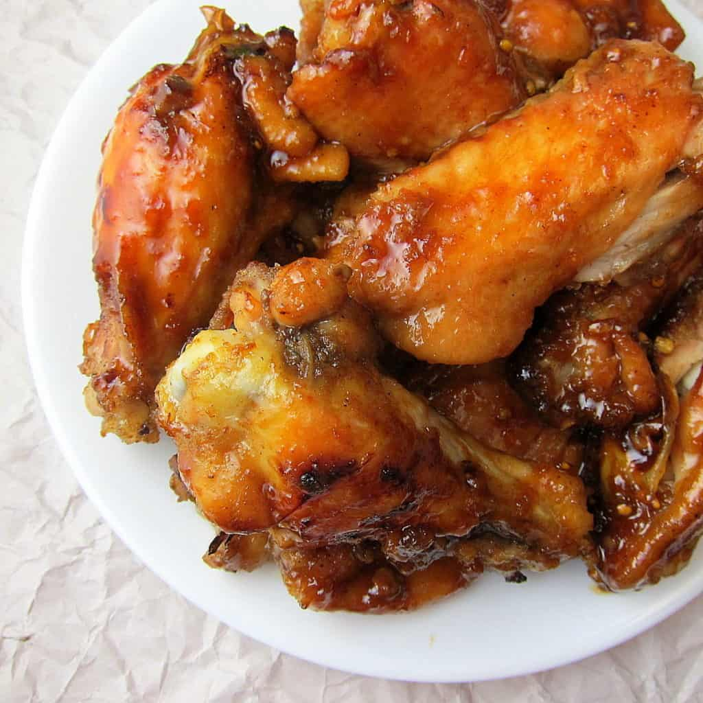 plate of chicken wings with honey garlic ginger sauce