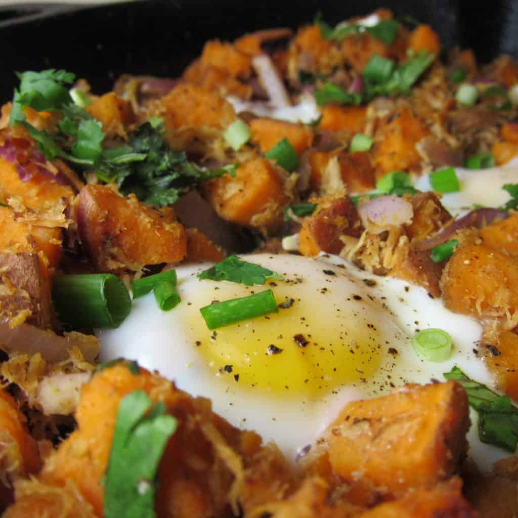 close up image of Pulled Pork Sweet Potato Hash with an egg on top
