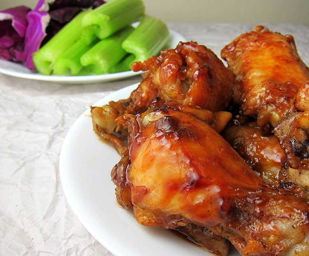 honey garlic wings with veggies in the background