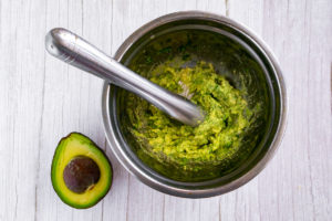 mashed avocado in a bowl to make avocado egg salad