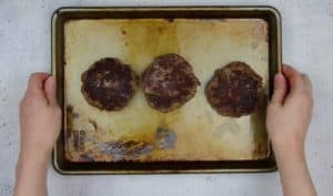 image of venison burger patties on a baking dish