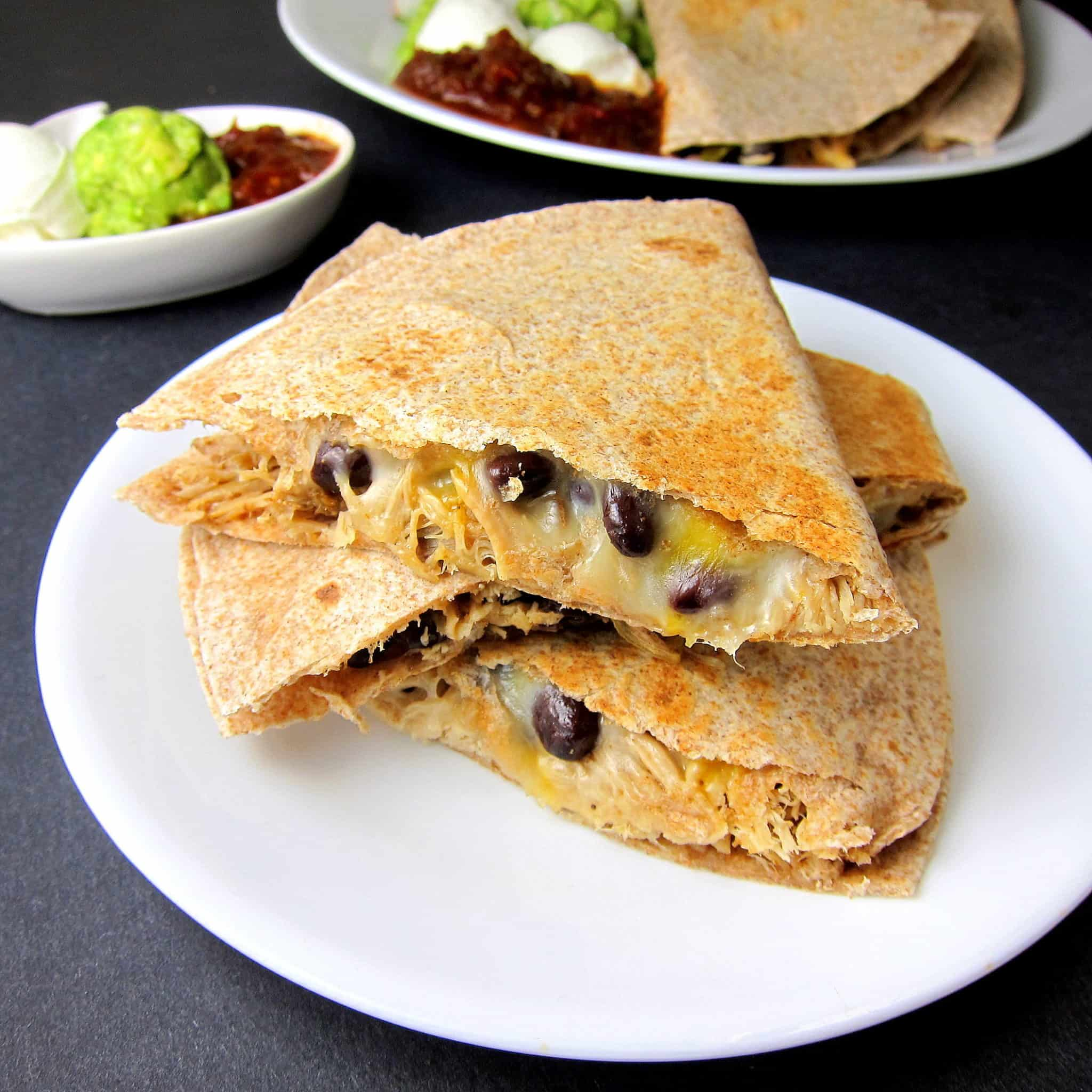 black bean pulled pork quesadilla on a plate