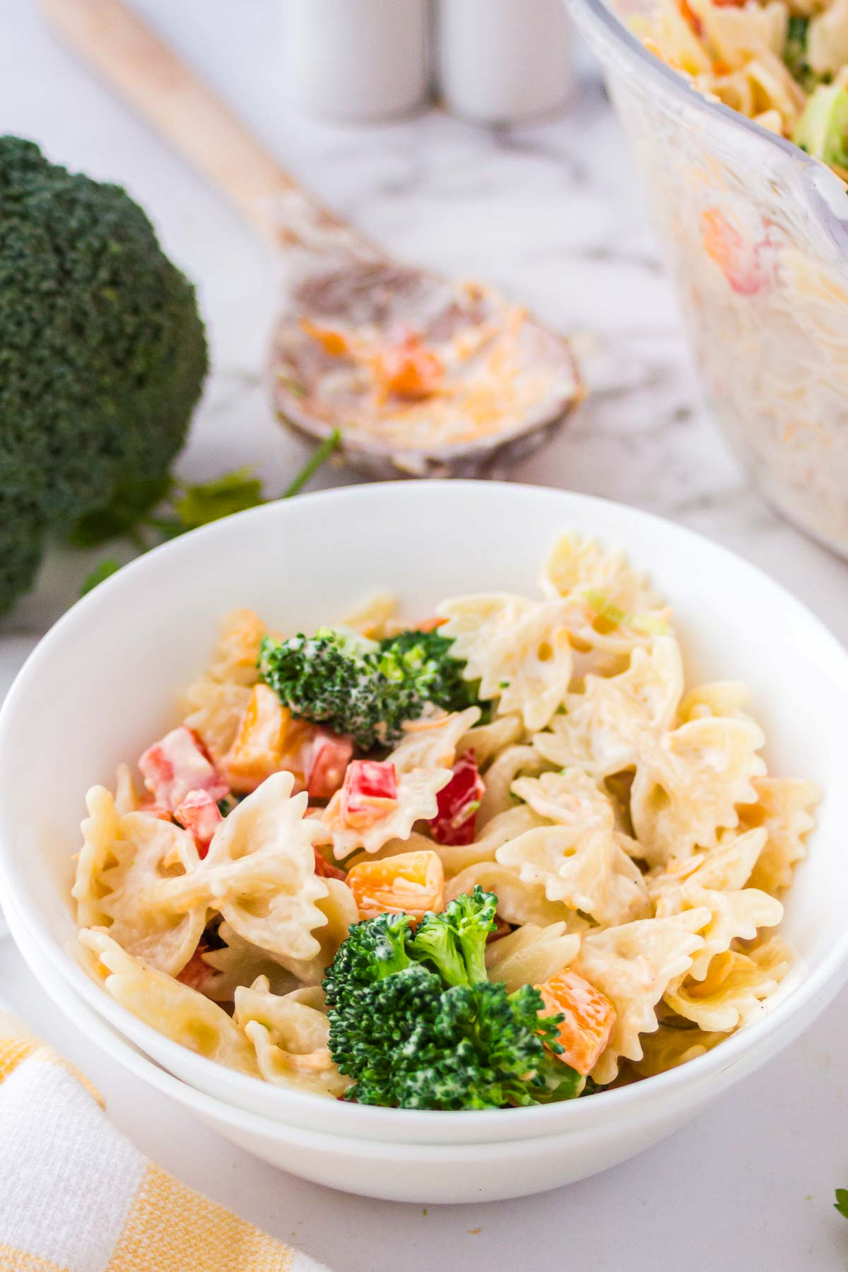 Bow tie pasta salad with broccoli in a bowl.