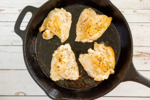 chicken thighs in a skillet