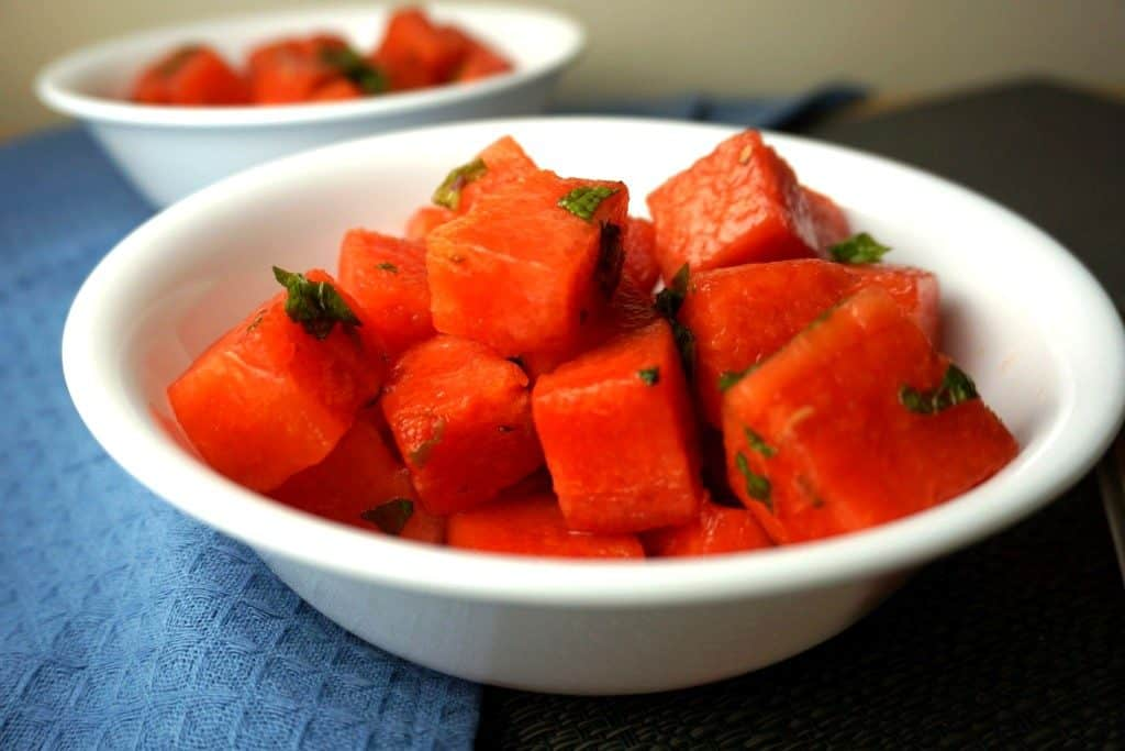 watermelon salad with honey lime dressing in a bowl