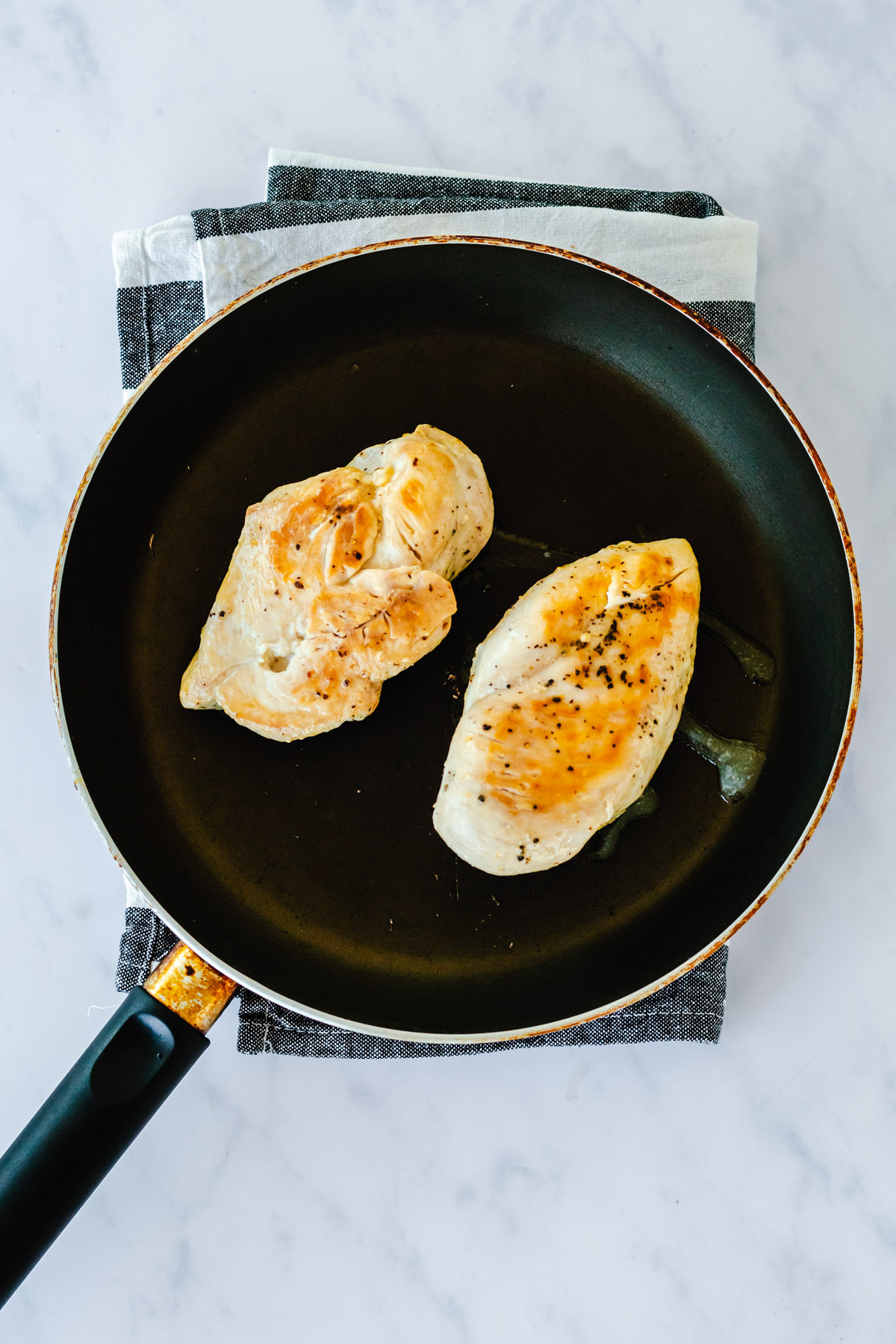 cooked chicken breasts in a pan