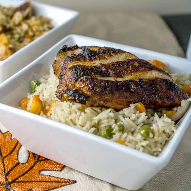 image of blackened chicken over rice pilaf