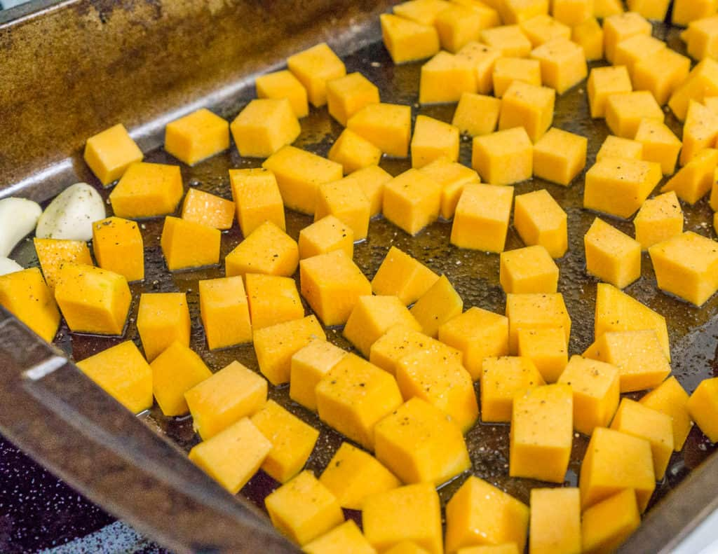 cubed butternut squash on a roasting pan