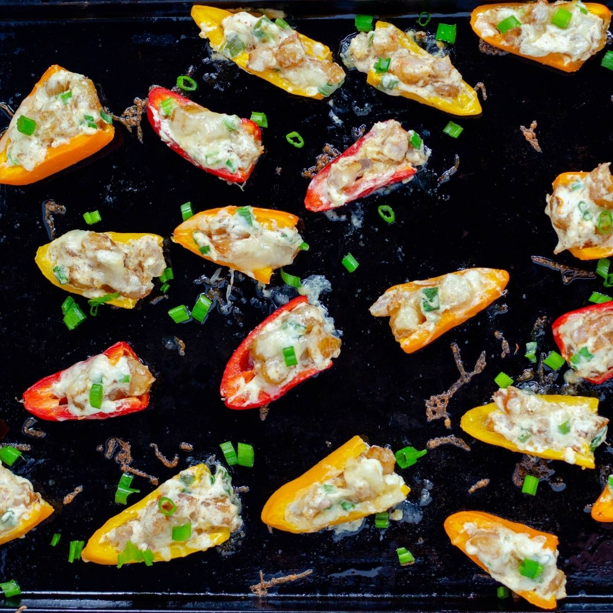 cream cheese and shrimp stuffed peppers on a baking tray