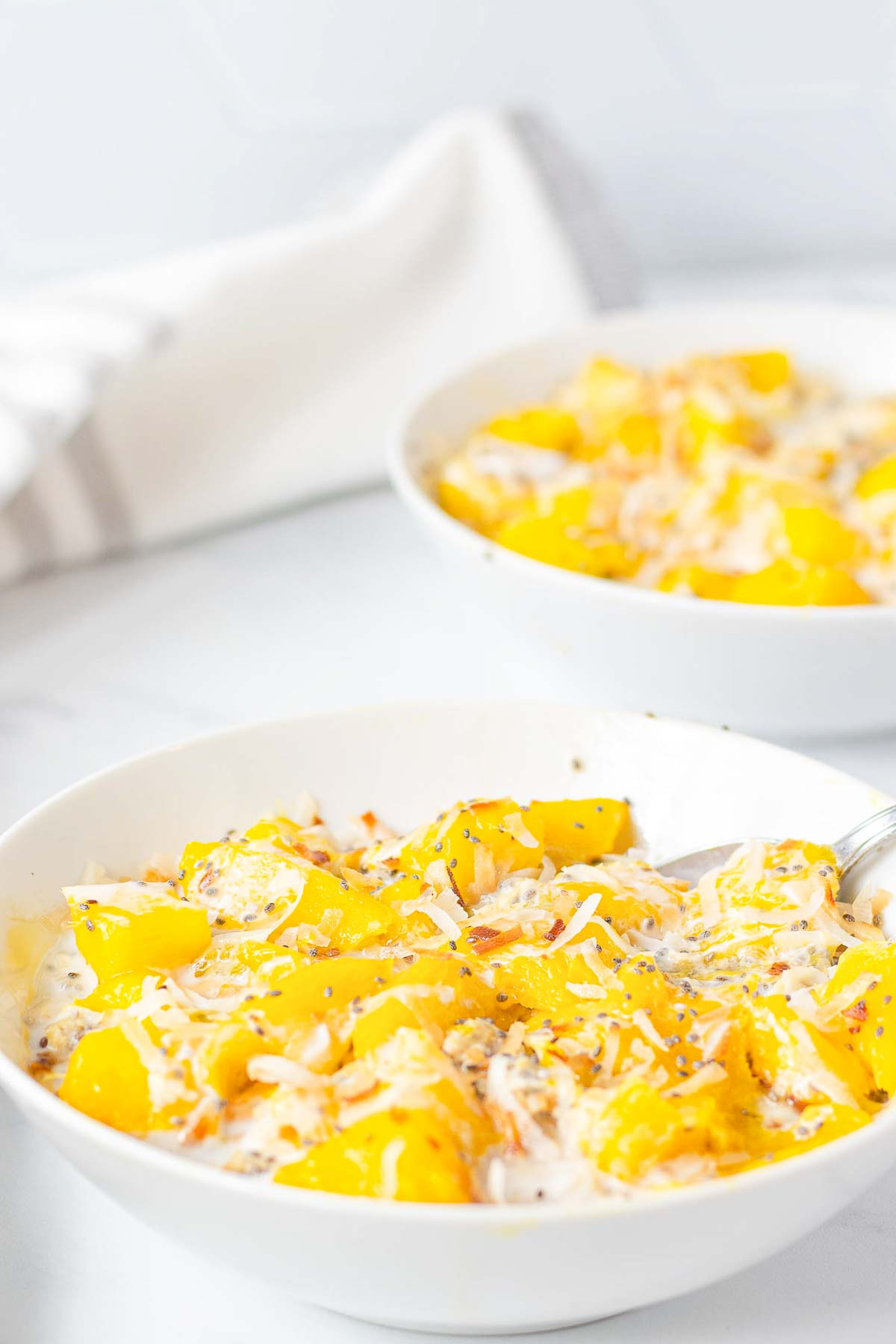 2 bowls of mango oatmeal with chia and coconut