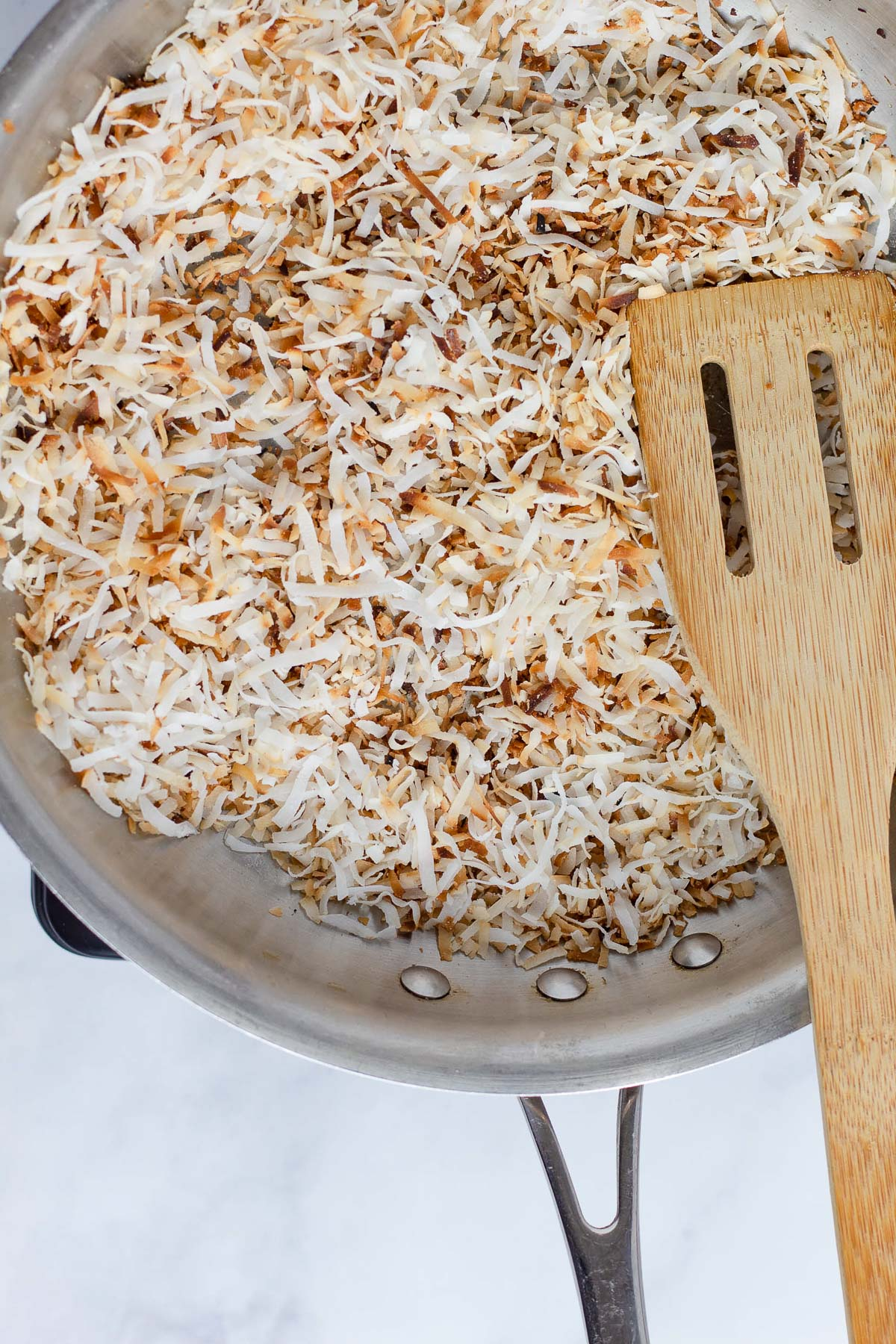 toasted shredded coconut in a pan