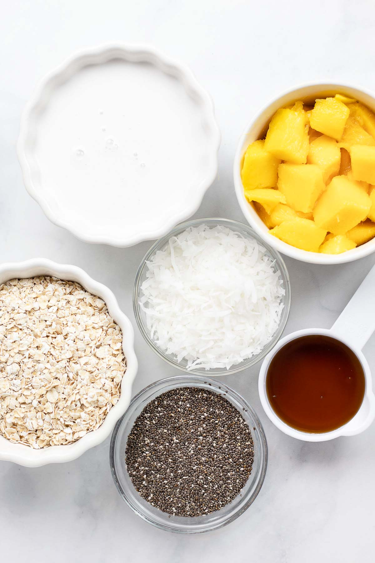 ingredients to make mango oatmeal with chia and coconut