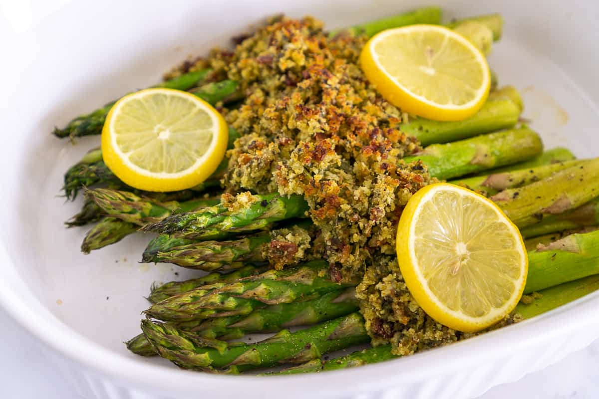 roasted asparagus side dish with bacon topping
