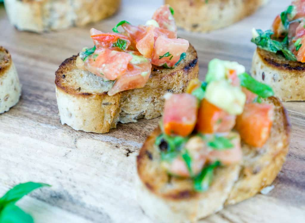 This Tomato Avocado Bruschetta is a delicious twist on the classic bruschetta. The creamy avocado pairs perfectly with the fresh tomatoes, basil, and parsley. Serve this over toasted baguettes for the perfect appetizer. From https://www.babaganosh.org