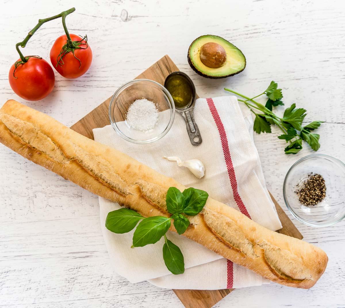 Ingredients for tomato avocado bruschetta.