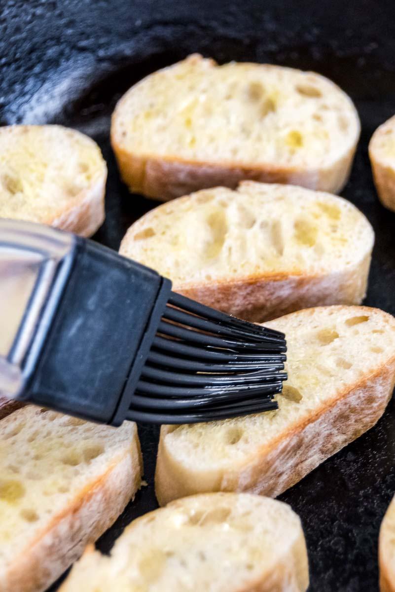 Toasting baguettes to make crostini.