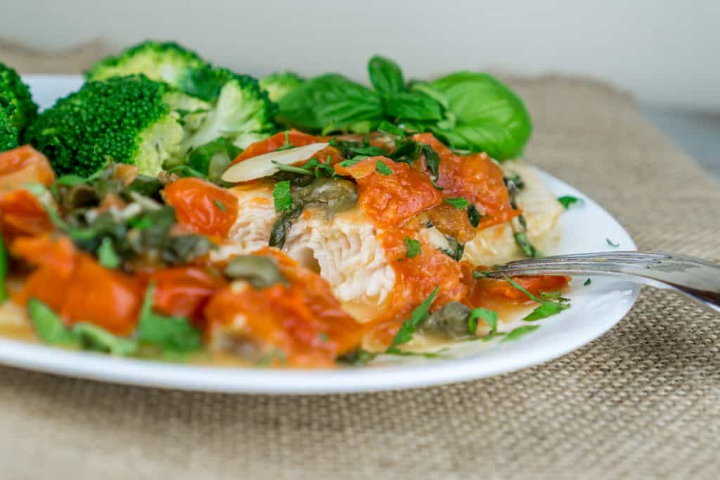 A truly wonderful dinner ready in 20 minutes! Tender flaky Swai Fillets with Tomato Caper Sauce topped with fresh herbs is irresistible, easy to cook, and very healthy. This recipe is great way to use seasonal produce and herbs. From https://www.babaganosh.org