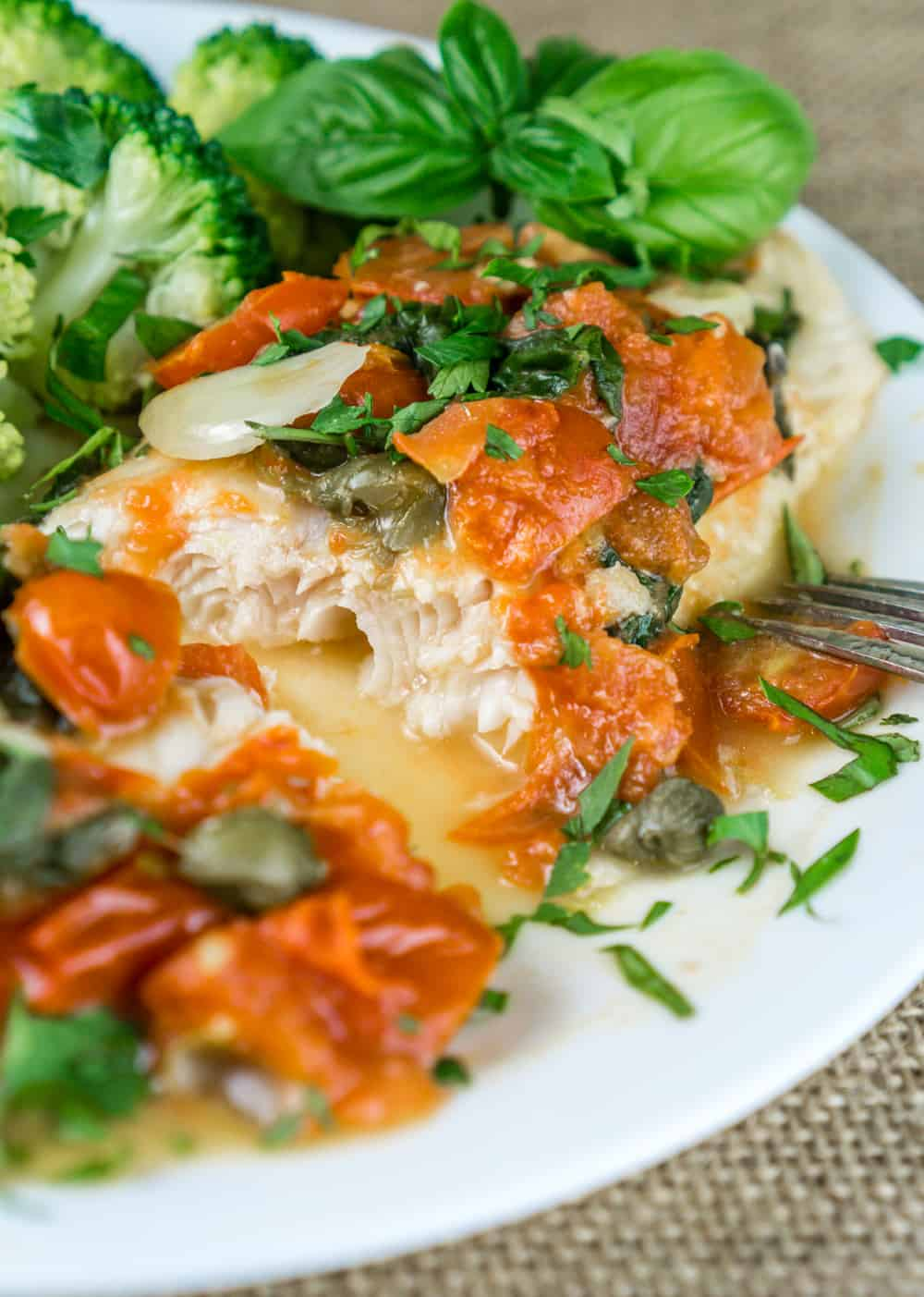 A truly wonderful dinner ready in 20 minutes! Tender flaky Swai Fillets with Tomato Caper Sauce are irresistible, easy to cook, and very healthy. This recipe is great way to use seasonal produce and herbs. From https://www.babaganosh.org