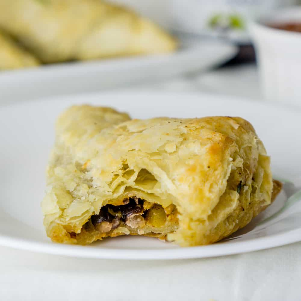 Black Bean Puff Pastry Triangles are the perfect after-school snack! From https://www.babaganosh.org