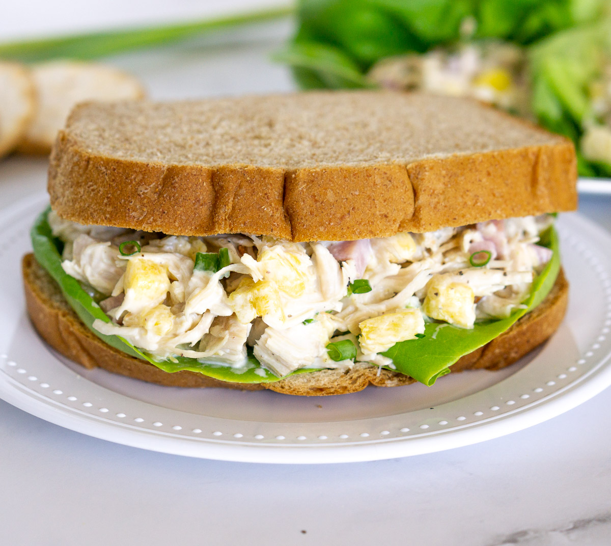 chicken salad with pineapples in a sandwich